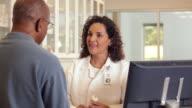 'pharmacist consulting about prescription use/Richmond,Virginia, USA'