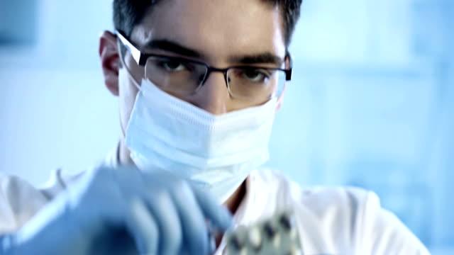 Pharmacist holding a pill