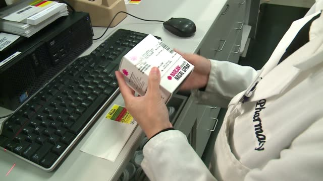 WGN Pharmacist Places Box of Narcan Naloxone Nasal Spray Into a clear plastic Bag in Chicago on September 19 2016