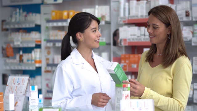 Pharmacist suggesting a product to a female customer