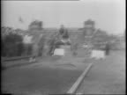 Philadelphia British and French sailors race in half mile relay / feature of Franklin Field games / A men pole vaults over the bar landing smoothly /...