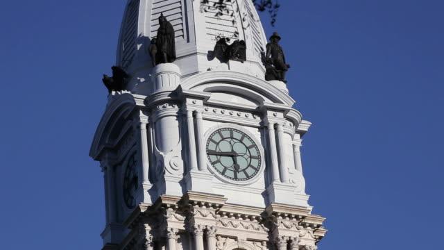 MS Philadelphia City Hall central tower clock and statues / Philadelphia, Pennsylvania, United States