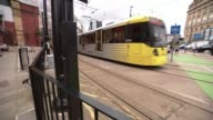 Woman appears in court ENGLAND Manchester INT Victoria Station Various of tram along