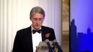 Philip Hammond speech at Mansion House ENGLAND London INT Philip Hammond MP sitting in audience / obscured shot of Lord Green speech SOT / Philip...