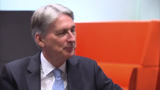 London IBM INT Philip Hammond MP visiting IBM and chatting to staff members