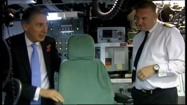 Philip Hammond visitsFaslane Naval Base SCOTLAND River Clyde Faslane Naval Base Victorious ***FLASH Crew at control desk in submarine wearing head...