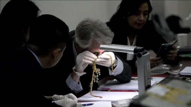 Philippine authorities showcase necklaces with diamonds the size of marbles and other jewels seized from the family of late dictator Ferdinand Marcos...