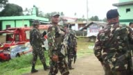 Philippine security forces bomb residential areas in a southern city as they battle Islamist militants holding hostages and reported to have murdered...