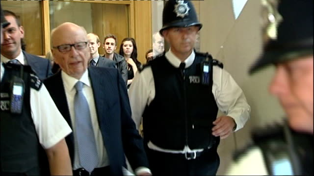 Rupert Murdoch branded unfit by Culture Select Committee report LIB / TX Portcullis House Murdoch flanked by police along to committee room