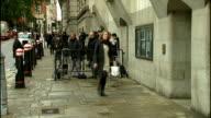 Alternate angle arrivals ENGLAND London Old Bailey GVs people along outside the Old Bailey / Mark Hanna along into Court / Rebekah Brooks and husband...