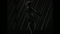 Phosphorescent silhouette shot of morning gabardine tailored suit entitled 'Emule' spotlight shows figure and suit behind silhouette / MS silhouette...