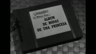Photo album 'De Monaco IlegaÉAlbum debdas de ulna princessa' on loosely woven material / VS photos of Princess Grace and Rainier at their church...