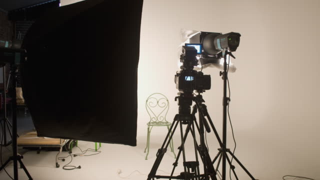 T/L, WS, Photographer photographing fashion model in studio, Auckland, New Zealand