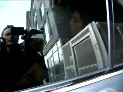 Photographers surround car with Amy Winehouse inside/ MS Interview with paparazzi photographer/ London England/ AUDIO