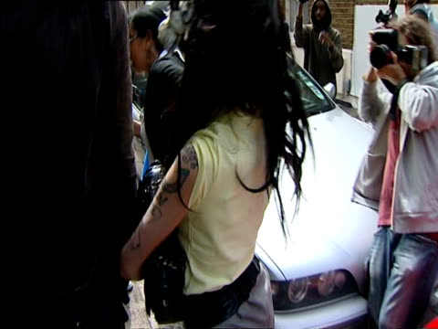Photographers swarming Amy Winehouse as she leaves her house to go to police station to face assault charges on April 25 2008 / MS Photographers...