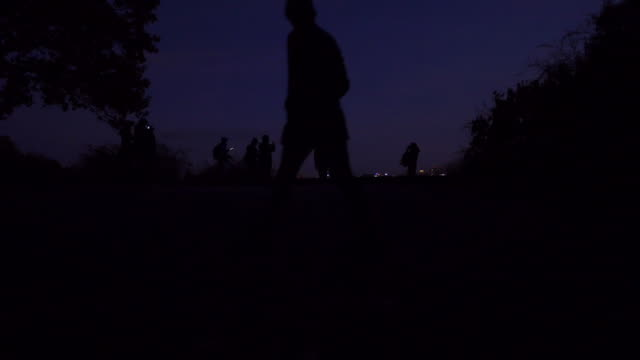 Photographers Taking Night City Pictures From A Hill