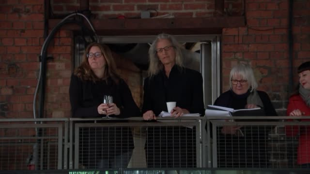 New Annie Leibovitz exhibition opens in London INT Annie Leibovitz standing with others at exhibition of her work Leibovitz