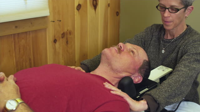 MS PAN Physical therapists working with patient / Manchester, Vermont, USA