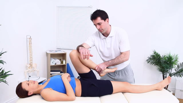 Physiotherapist manipulating a knee