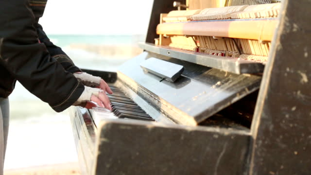 pianist and an old piano