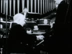 Pianist Arthur Rubinstein performs with the Polish National Philharmonic on Frederick Chopin's 150th anniversary
