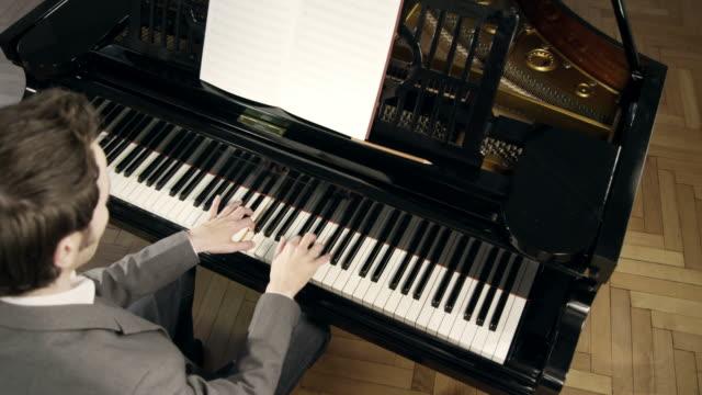 Pianist composing music
