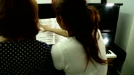Pianist teacher teaching and playing music