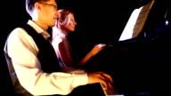 Piano duet.