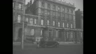 145 Piccadilly the home of Prince Albert Duke of York / person exits car and enters house / people gathered at fence / Princesses Elizabeth Margaret...