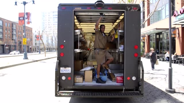 UPS Pick Up and Delivery worker truck unloading UPS Pick Up and Delivery on April 01 2012 in San Francisco California