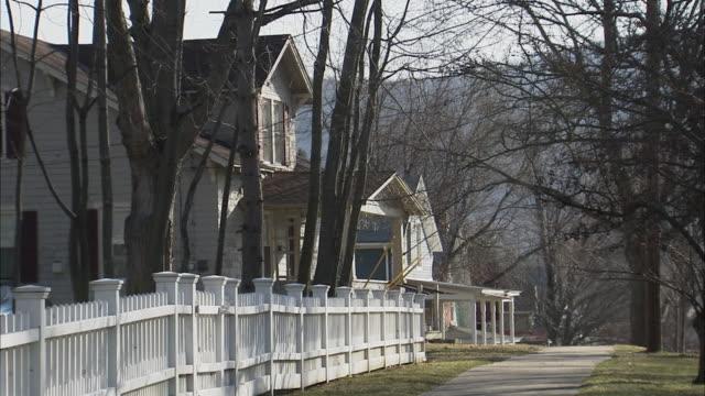WS Picket fence down street / Rutland, Vermont, USA