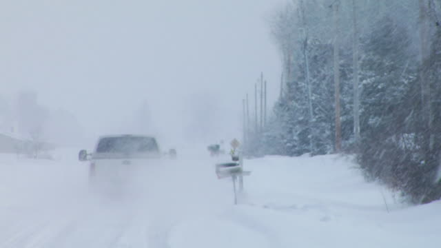 WS Pickup truck driving down country road in snowstorm/ Hortonville, Wisconsin