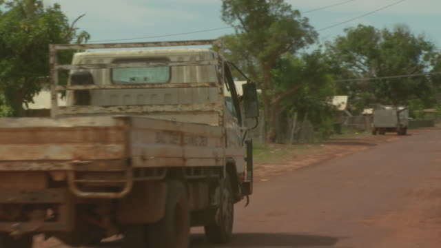Pick-up truck on dirt road, Maningrida Indigenous Community, NT, Australia
