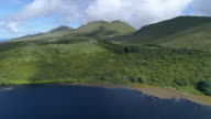 Pico Island highland with green hills and blue lake, aerial