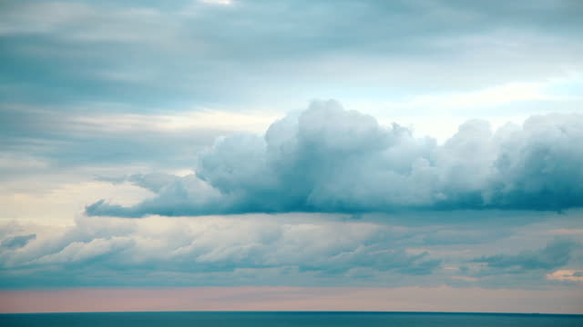 Picturesque clouds over the sea, time laps