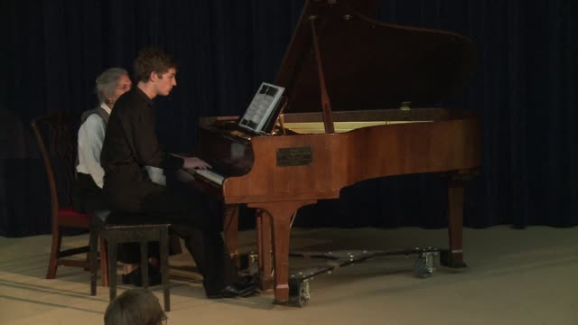 A piece of piano music written in the Dachau Nazi concentration camp has been given its US premiere by a 17 year old grandson of Holocaust survivors...