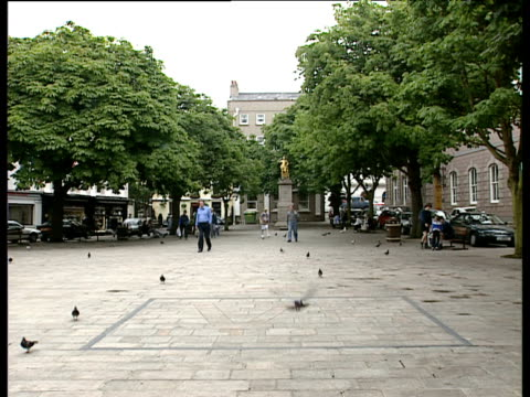 Pigeons and pedestrians in Royal Square St Helier Jersey