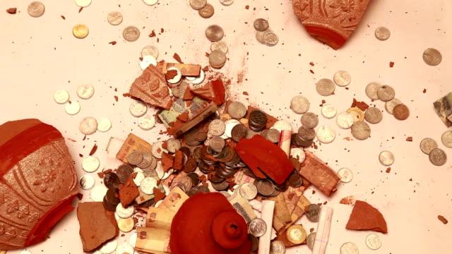 Piggy Bank Falling & Breaking