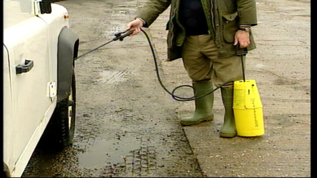 Pigswill ban proposed / Farms disinfected ITN EXT GV Farmer along with disinfectant pump set ups farmer along to disinfect tyres of car with liquid...