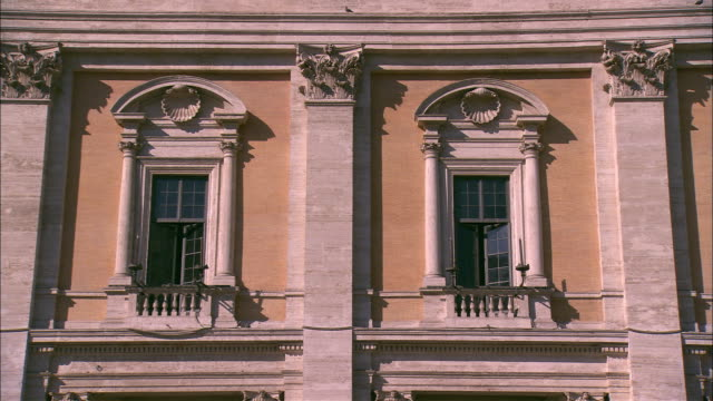 Pilasters separate ornate windows at Piazza del Campidoglio in Rome, Italy.