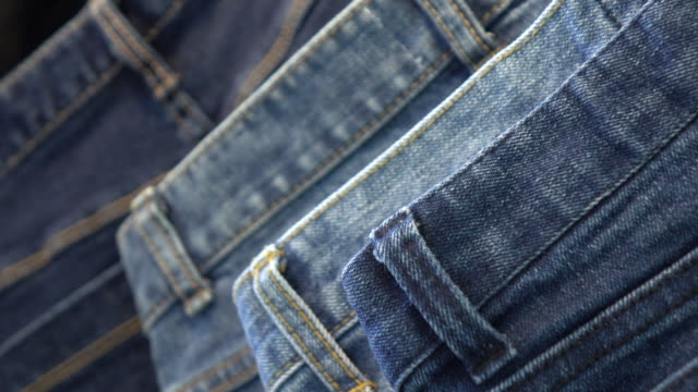pile of blue and black jeans