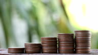 pile of coin stack on wooden floor in business concept and finance account.