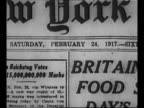 Pile of newspaper front pages ZI to New York Times front page dated 1917 / pile of newspaper stories zoom into headline about food riots / crowd of...