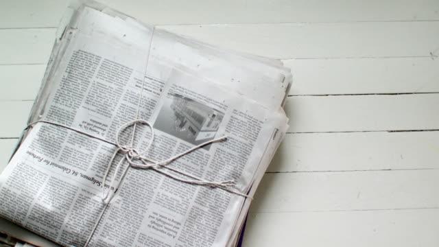 CU HA Pile of newspapers on floor, Scarborough, New York, USA