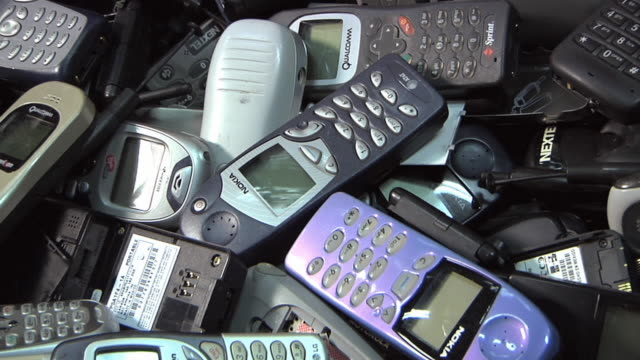 CU ZO Pile of obsolete and broken cell phones / Dexter, Michigan, USA
