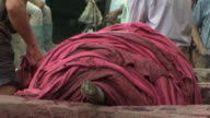 CU Pile of skins dyed red in leather tannery, Fez, Morocco