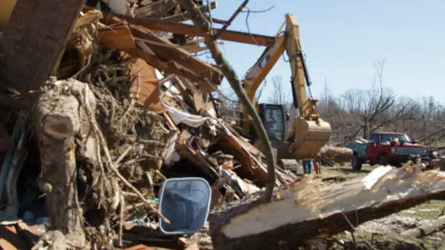 Piles Of Debris, With Quick Shots Of People And Machinery Working In Background
