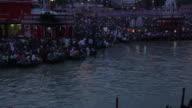 Pilgrims at riverbank at dusk, Ganges River, Haridwar, Uttarakhand, India