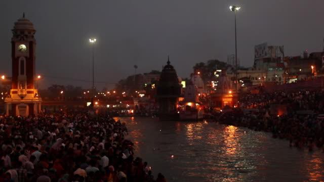 Pilgrims at riverbank at night, Ganges River, Haridwar, Uttarakhand, India