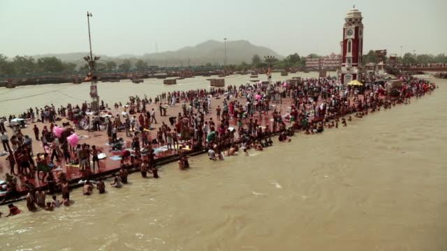 Pilgrims bathing at riverbank, Ganges River, Haridwar, Uttarakhand, India